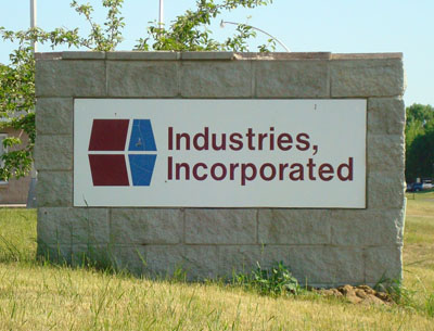 Stone monument-style sign at Industries, Inc. in Cambridge, MN.