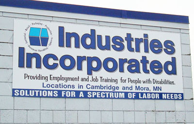 A sign on the Mora Industries, Inc. builidng explains the company's purpose.
