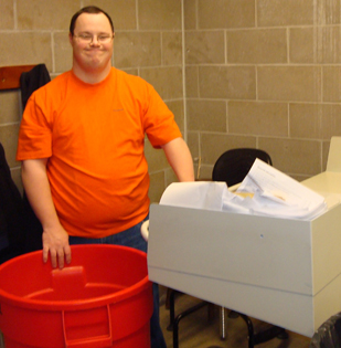 A man proudly poses at his shredding job.